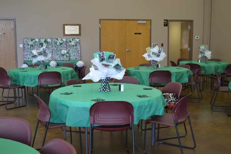 gather pics from the cheer parents from throughout the season and make pic collages on bulletin boards make colorful centerpieces for each table